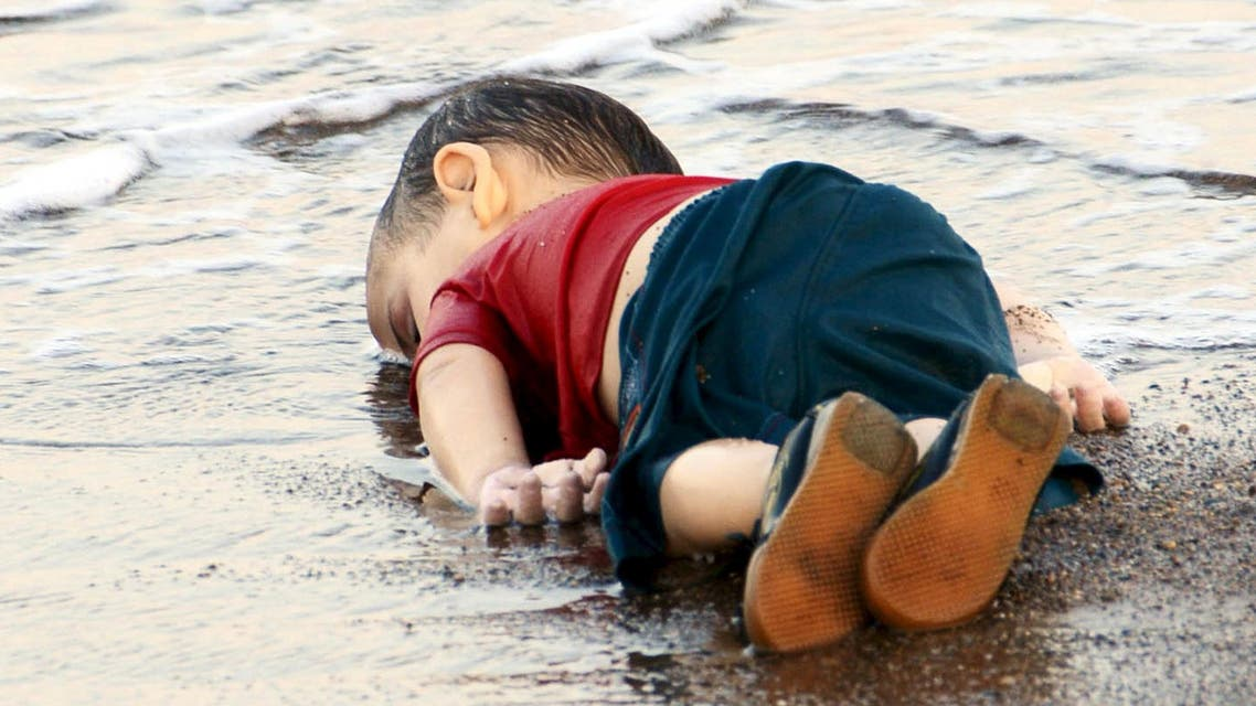 A young migrant, who drowned in a failed attempt to sail to the Greek island of Kos, lies on the shore in the Turkish coastal town of Bodrum, Turkey, September 2, 2015. (Reuters)