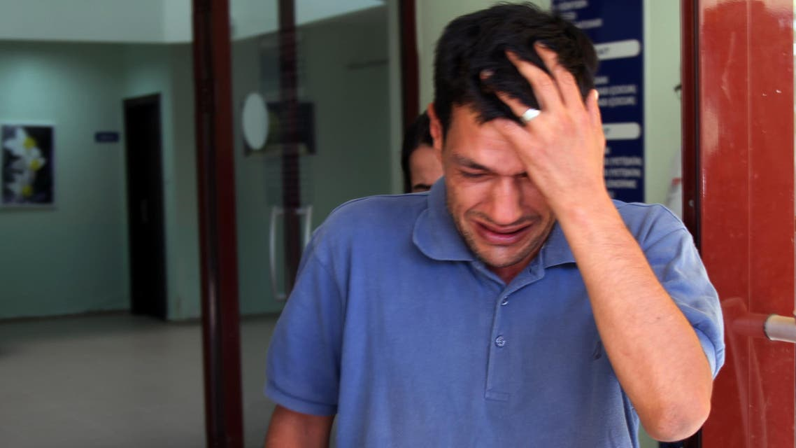 Abdullah Kurdi, 40, father of Syrian boys Aylan, 3, and Galip, 5, who were washed up drowned on a beach near Turkish resort of Bodrum on Wednesday, cries as he waits for the delivery of their bodies outside a morgue in Mugla, Turkey. (AP)