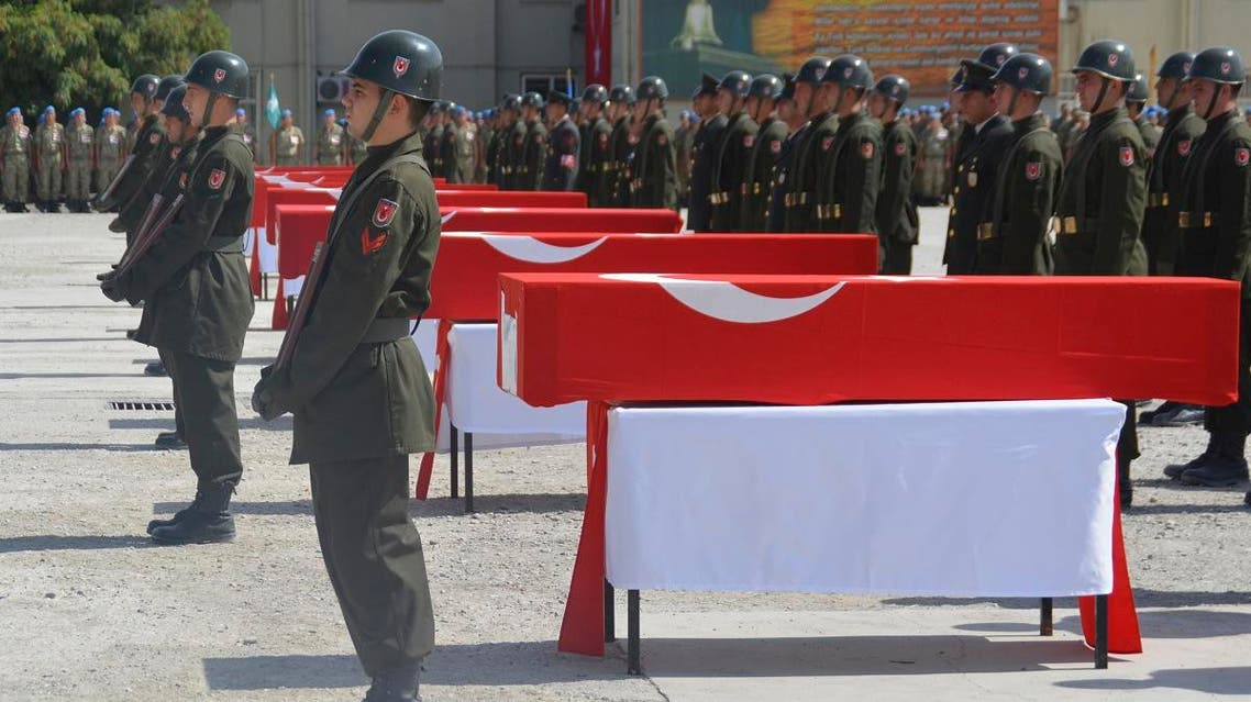In this Thursday, Aug. 20, 2015 photo, made available Friday Aug. 21, 2015, Turkish soldiers stand in attention next to the Turkish flag-draped coffins of eight Turkish soldiers, killed on a roadside bomb. (AP)