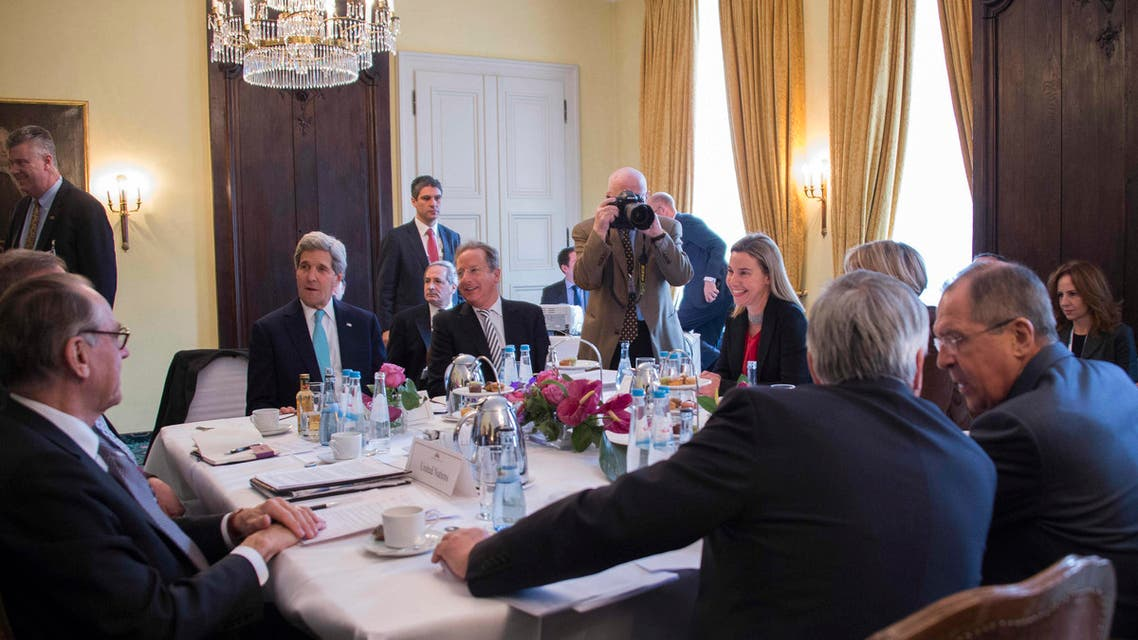 """Secretary of State John Kerry (2nd L) talks during a meeting with Russian Foreign Minister Sergei Lavrov (R) and other members of the the Quartet on the Middle East on the third day of the 51st Munich Security Conference (MSC) in Munich, Germany, Sunday, Feb. 8, 2015. The Ukraine conflict, Islamic State group jihadists and the wider """"collapse of the global order"""" occupy the world's security community at the annual meeting. Also on the agenda of the three-day Conference are Iran's nuclear talks, the Syrian war and mass refugee crisis, West Africa's Ebola outbreak and cyber terrorism. (AP Photo/Jim Watson, Pool)"""