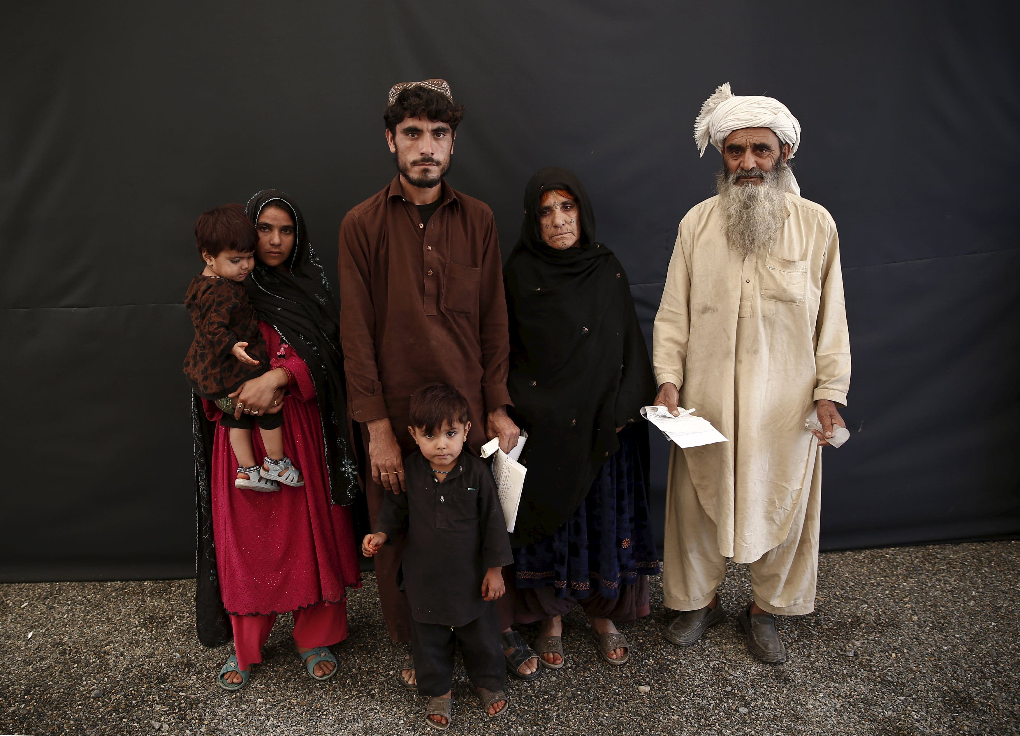 Rahim Khan (R) poses for a picture with his family after they arrive at a United Nations High Commissioner for Refugees (UNHCR) registration centre in Kabul, Afghanistan August 26, 2015. reuters