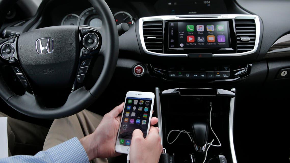 Chris Martin from Honda North America demonstrates Apple CarPlay. (AP)