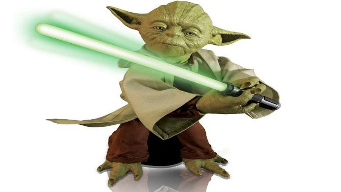 This product image provided by Spin Master Corp. shows the company's Legendary Yoda toy. The toy is 16 inches tall and boasts lifelike movements and voice recognition. (Spin Master Corp. via AP)