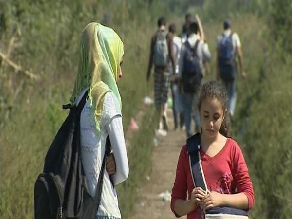مهاجرون في رحلة بحث عن أمل على حدود صربيا والمجر