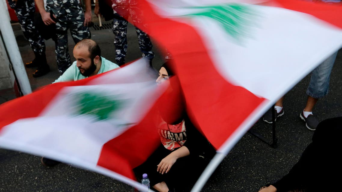 Lebanese activists wave national flags and shout slogans outside the interior ministry during a sit-in in Beirut, Lebanon, Thursday, Sept. 3, 2015 (AP)