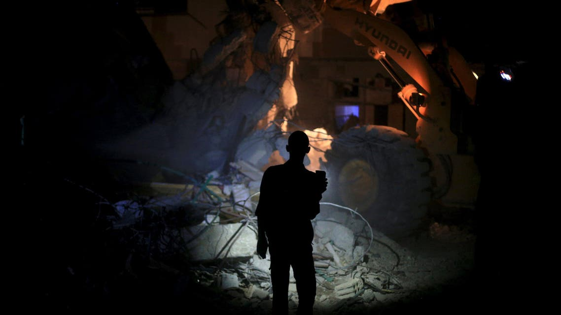 File photo: A resident inspects damage from what activists said was barrel bombs dropped by forces loyal to Syria's President Bashar Al-Assad in Douma, Eastern Al-Ghouta, in August. (Reuters)