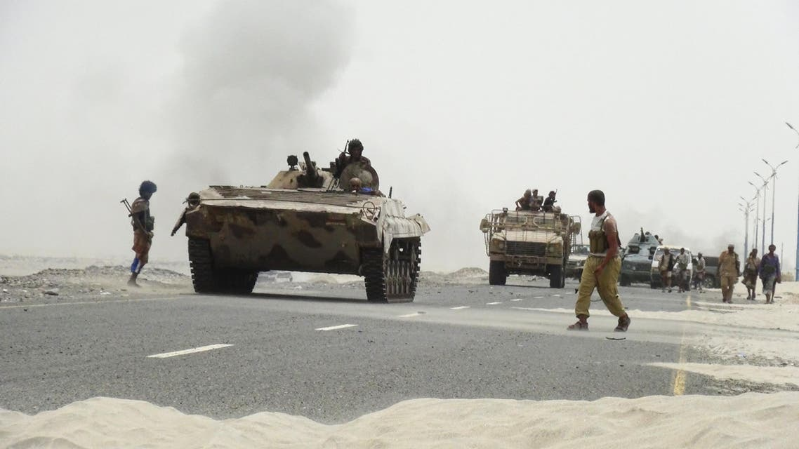 Southern Resistance fighters gather on a road leading to Yemen's Houthi-held southern province of Abyan. (Reuters)