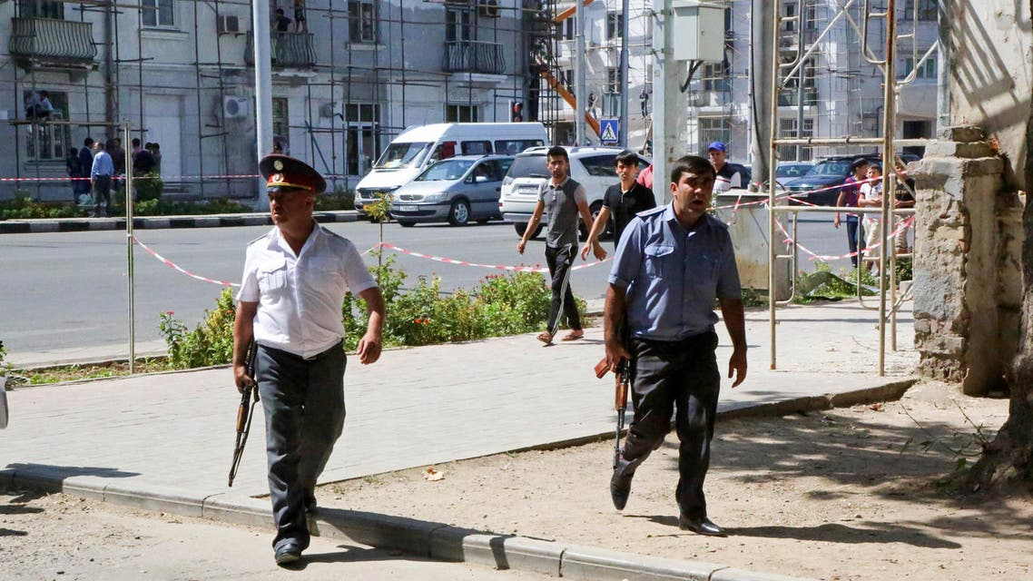Police officers secure an area in the capital of Tajikistan, Dushanbe, where several Interior Ministry special forces officers and a traffic policeman were reportedly shot dead earlier on Friday, Sept. 4, 2015. Armed groups led by a disaffected deputy defense minister mounted attacks Friday in and near the capital of Tajikistan that left at least eight police officers and nine militants dead, authorities said. (AP Photo/Peter Leonard)