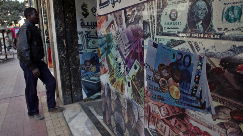 A Man Walks Next To Currency Exchange Office In Downtown Cairo Egypt Wednesday Jan 2 2017 File Photo Ap