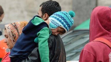 ألمانيا تطالب بالضغط ليقبل الأوروبيون حصص اللاجئين