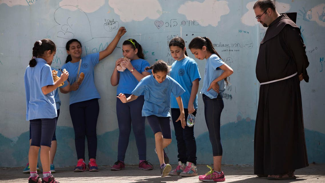 Arab Israeli Christian school children play at the Terra Santa School in the mixed Jewish-Arab city of Ramle, Israel. (File: AP)