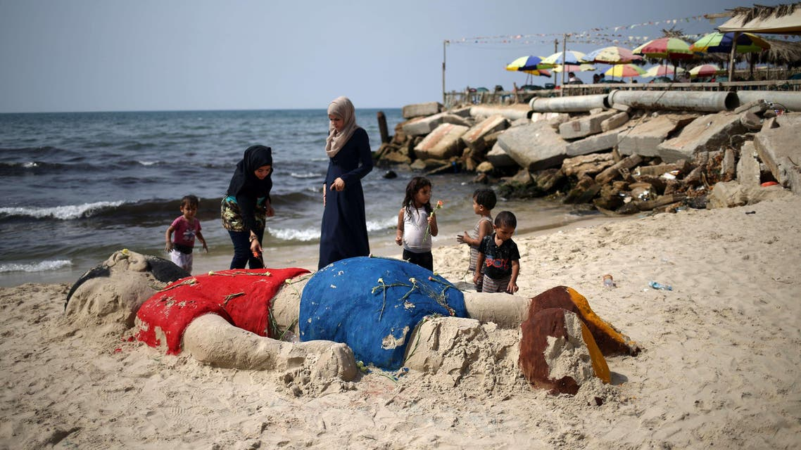 Palestinians paid tribute to the tiny boy who drowned while fleeing the Syrian war by building a sand sculpture of him AFP