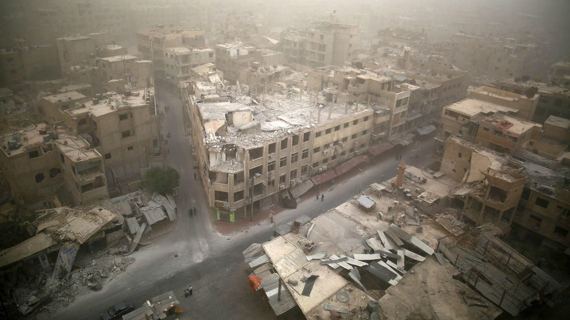 A picture taken on September 7, 2015 shows a general view of damaged buildings in the rebel-held area of Douma, east of the capital Damascus as a sandstorm blows over the city. AFP PHOTO / SAMEER AL-DOUMY