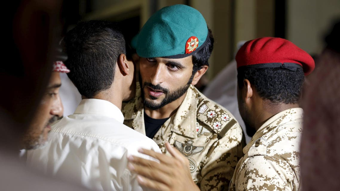 Head of Protocol and representative of the King of Bahrain, Sheikh Nasser bin Hamad al Khalifa (C) receives family members of Bahrainis killed in Yemen. (Reuters)