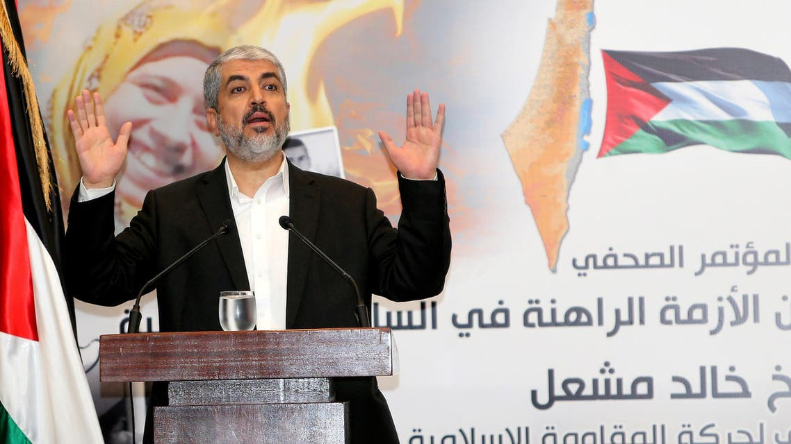 The exiled head of Palestinian Islamist movement Hamas, Khaled Meshaal, gestures during a press conference in the Qatari capital Doha. (AFP)