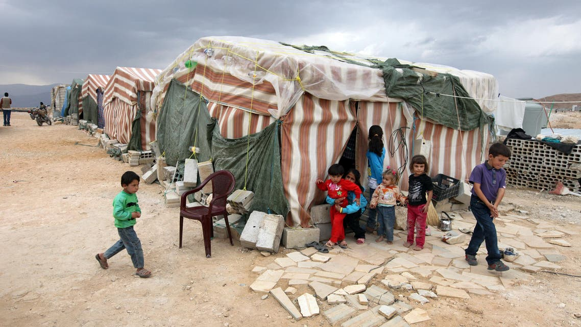 Syrian refugees children stand in front of their tents at a refugee camp in Arsal, a Sunni Muslim town eastern Lebanon near the Syrian border, that has become a safe haven for war-weary Syrian rebels and hundreds of refugee families. AP