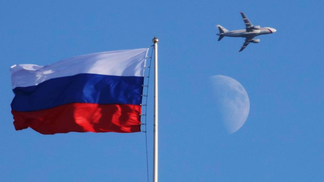 A plane flies over the Russian flag atop the Konstantin Palace in St.Petersburg, Russia, Friday, July 24, 2015. (AP)
