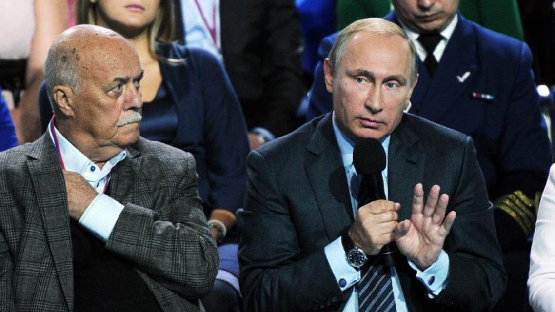 Russian President Vladimir Putin, right, speaks during a meeting with his supporters in Moscow, Russia, Monday, Sept. 7. (AP)