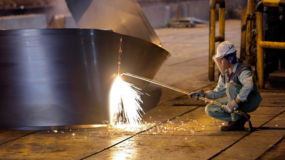 an Iranian worker cuts a steel roll at the Mobarakeh Steel Complex, some 2460km south of the capital Tehran. (File photo:AP)