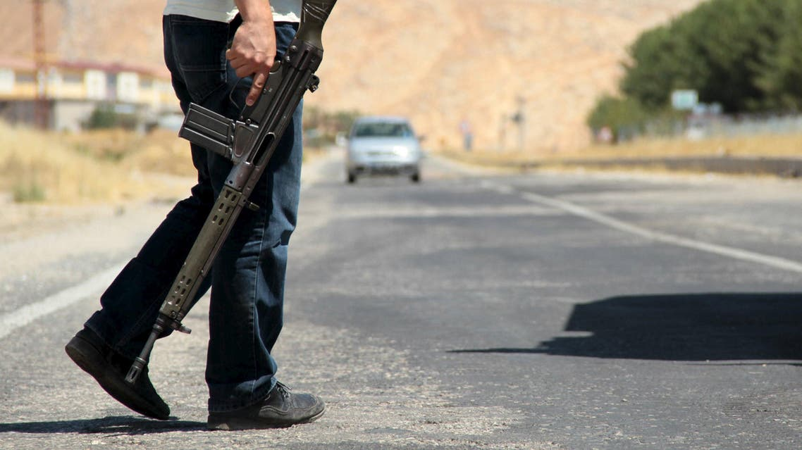 A member of the Turkish security forces stands guard at a check point on the main road to southeastern town of Silvan, near Diyarbakir. (File photo: Reuters)