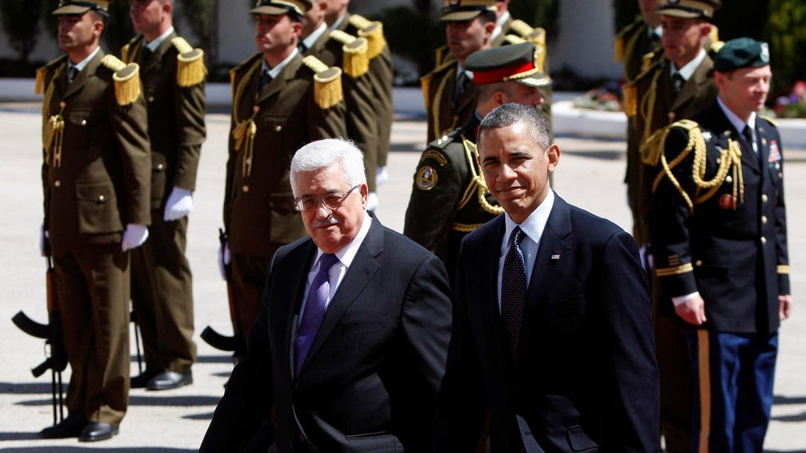 US President Barack Obama, right, walks with Palestinian President Mahmoud Abbas, during a welcoming ceremony prior to their meeting, in the West Bank city of Ramallah, Thursday, March. 21, 2013. Obama is meeting Palestinian officials on the second day of his Mideast tour to emphasize the importance of reaching an Israeli-Palestinian peace deal. (AP Photo/Majdi Mohammed)