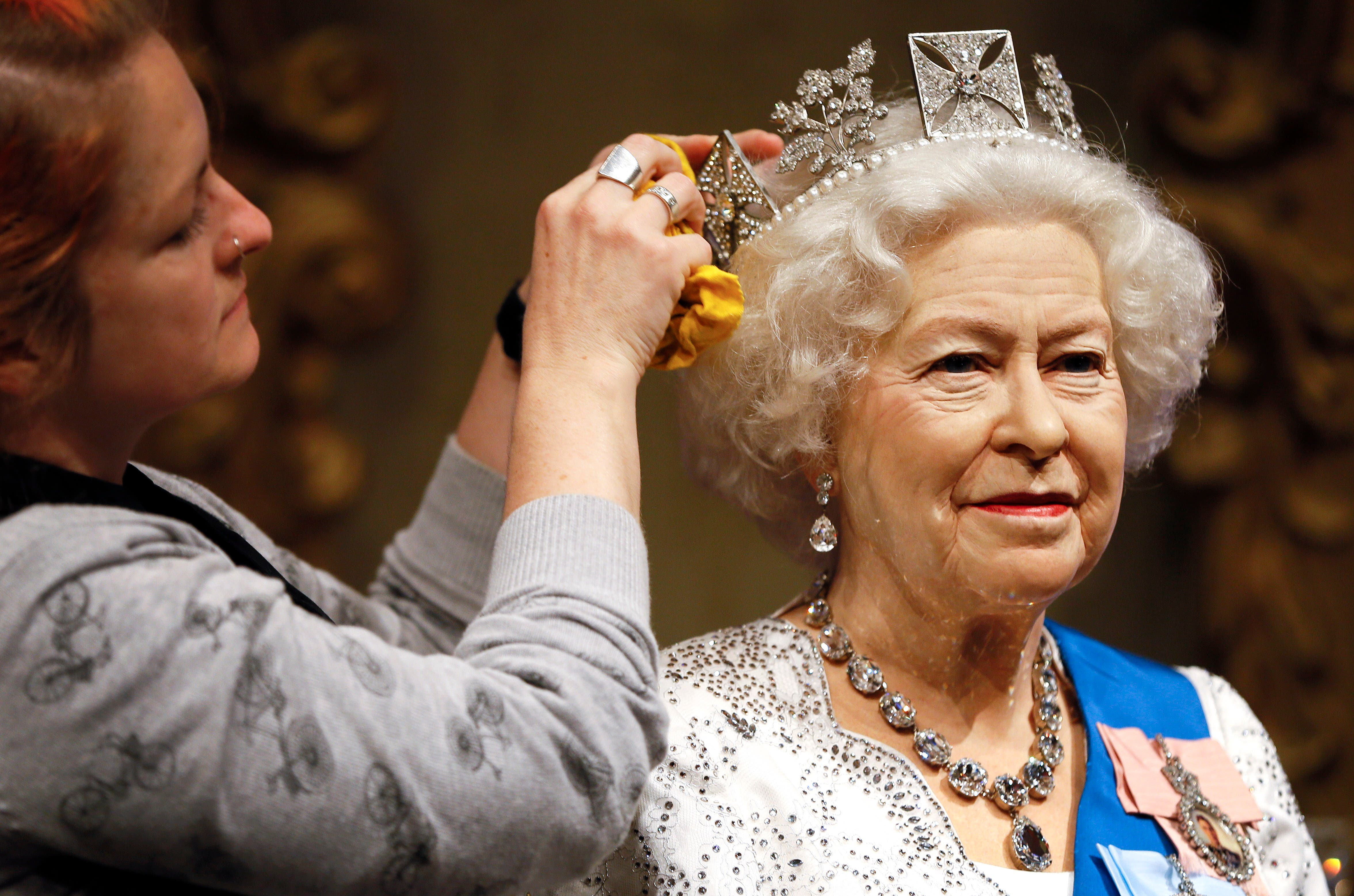 A wax work model of Britain's Queen Elizabeth II is prepared at Madame Tussauds in London, Monday, Sept. 7, 2015. AP