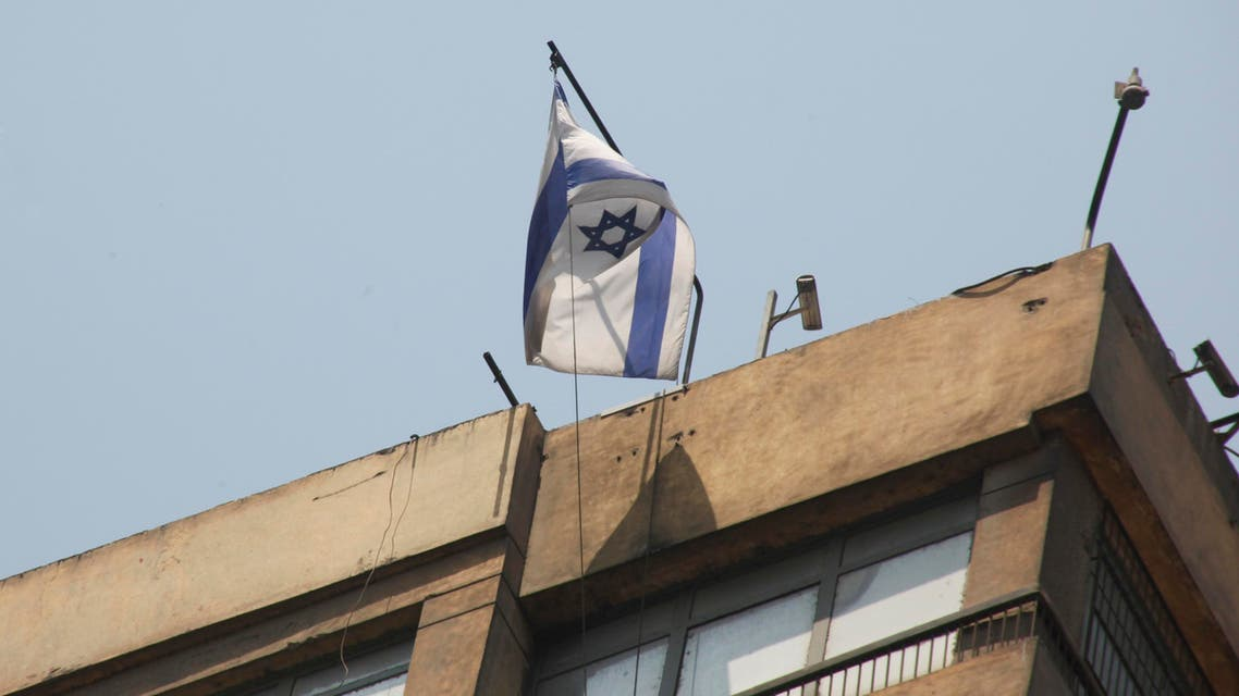In this image taken Saturday Aug. 20, 2011 shows an Israeli flag flying over the Israeli embassy in Cairo, Egypt, a day before a young Egyptian man managed, at dawn, to climb 15 floors on a high building where the Israeli embassy is located, to remove the Israeli flag from the embassy balcony and replace it with the Egyptian flag. Hundreds of Egyptians protest the deaths of Egyptian security forces killed in a shootout between Israeli soldiers and Palestinian militants on Thursday in the Sinai. Egypt said Saturday it would recall its ambassador from Israel to protest the deaths, sharply escalating tensions between the neighboring countries, whose 1979 peace treaty is being tested by the fall of Egypt's longtime autocratic leader, Hosni Mubarak. (AP Photo/Amr Nabil)