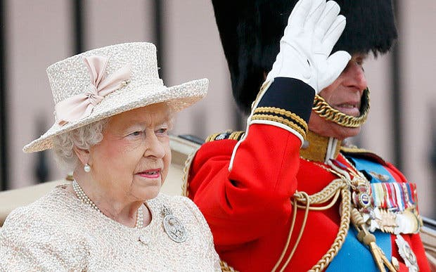 Britain's Queen Elizabeth and Prince Philip leave Buckingham Palace by carriage (REUTERS