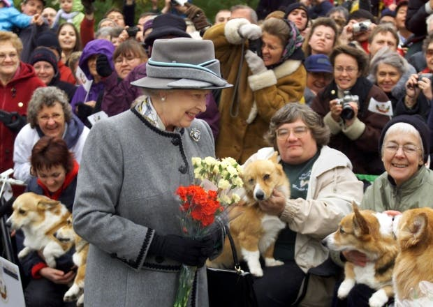 Queen Elizabeth greets the Manitoba Corgi Club as she tours the Forks Market in Winnipeg on Oct. 8, 2002, as part of her Golden Jubilee tour of Canada.