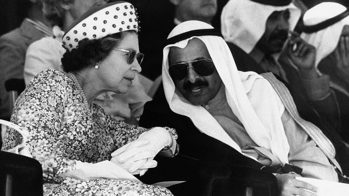 Kuwait's Defense Minister, dark-spectacled Salem Sabah, explains the stories behind Bedouin dances to the Queen Elizabeth II during her visit to Kuwait in Feb. 14, 1979. (File photo: AP)