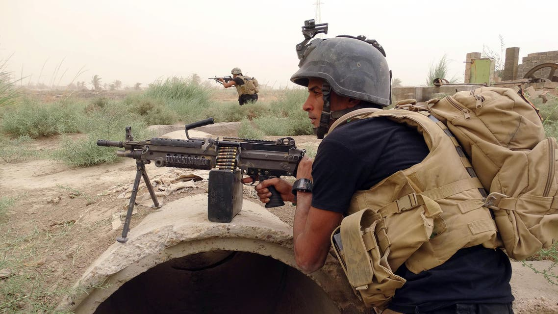 In this Tuesday, Sept. 1, 2015 photo, Iraq's Special Weapons and Tactics Team (SWAT) with U.S.-made weapons, prepare to attack Islamic State Group militants at the front line in the south suburbs of Ramadi, Anbar province, Iraq. (AP Photo)