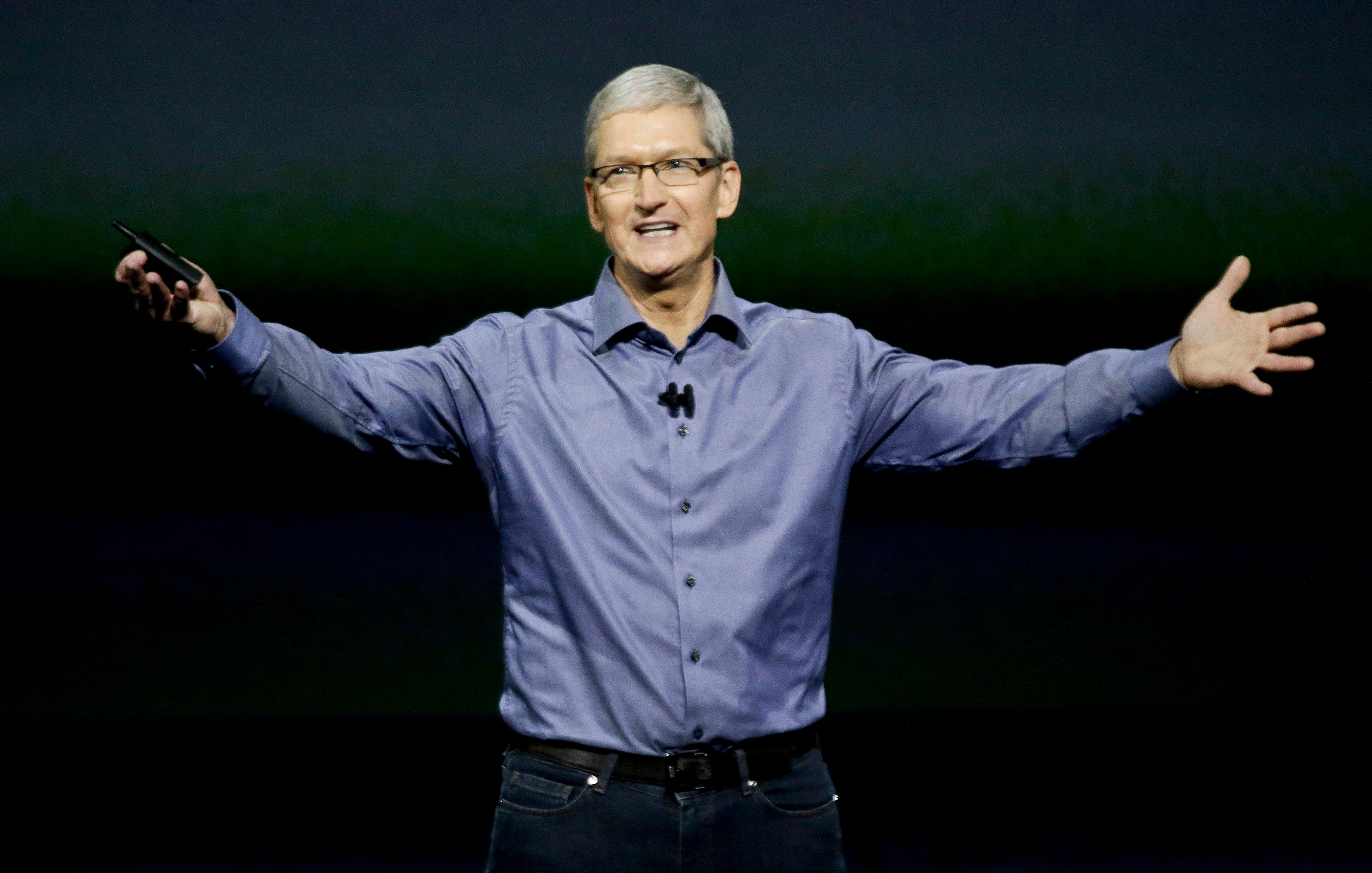 Apple CEO Tim Cook wraps up the latest Apple event at the Bill Graham Civic Auditorium in San Francisco, Wednesday, Sept. 9, 2015. (AP Photo/Eric Risberg)