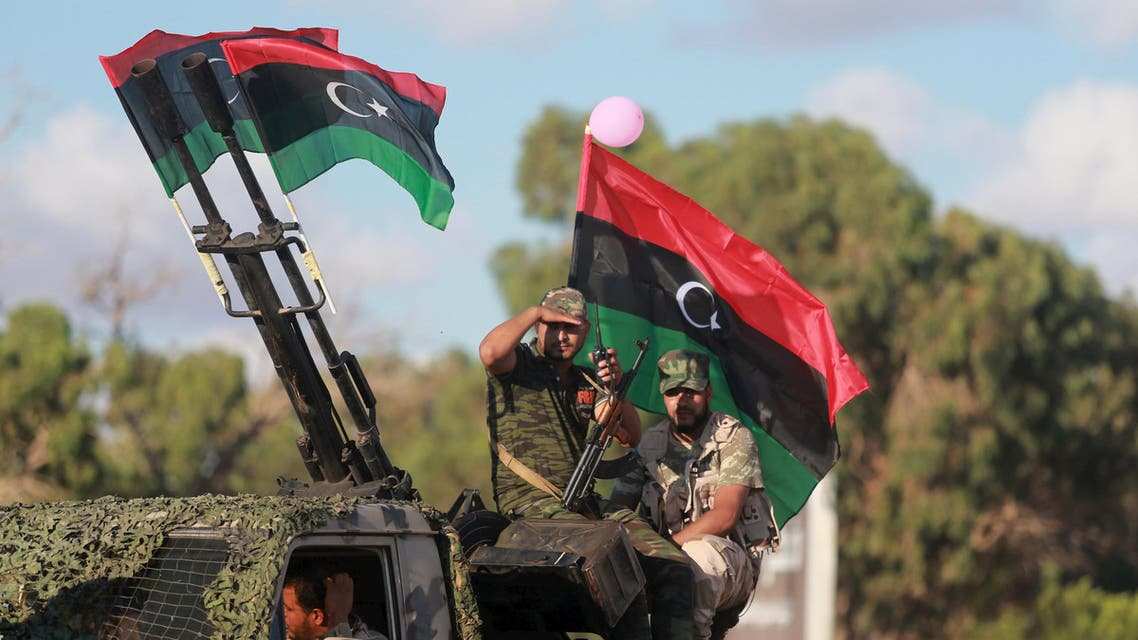 Members of the Libyan army give protection to a demonstration in support of the Libyan army under the leadership of General Khalifa Haftar, in Benghazi, Libya, August 14, 2015. REUTERS/Esam Omran Al-Fetori