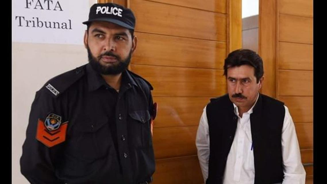 Pakistani lawyer Qamar Nadeem (R), representing doctor Shakeel Afridi who assisted the CIA in their hunt for Osama bin Laden, leaves the court after a hearing in Peshawar on September 9, 2015.
