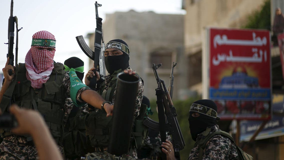 Palestinian Hamas militants take part in a military parade marking the first anniversary of the killing of Hamas's military commanders Mohammed Abu Shammala and Raed al-Attar, in Rafah in the southern Gaza Strip August 21, 2015. Abu Shammala and al-Attar were killed by an Israeli air strike during a 50-day war between the armed group and Israel last summer. REUTERS/Suhaib Salem