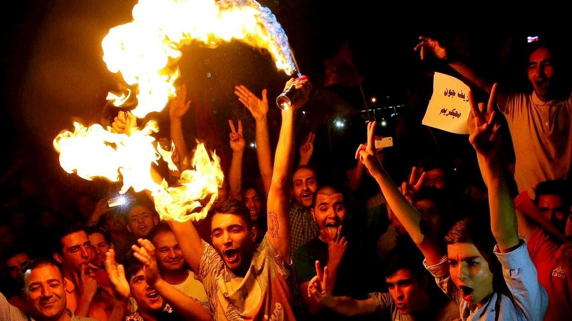 Iranians celebrate following a landmark nuclear deal in Tehran, Iran, Tuesday, July 14, 2015. (AP)