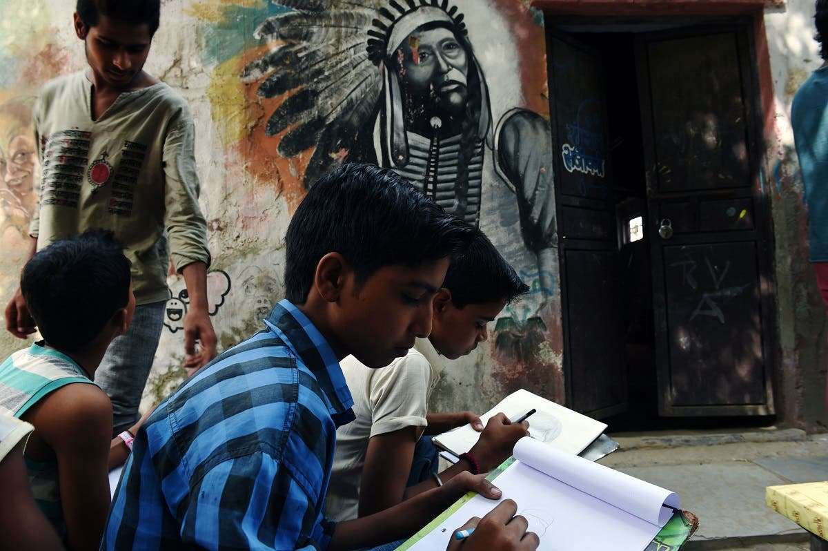 Indian students draw at an art school in Nangloi, a colony in west New Delhi. (AFP)