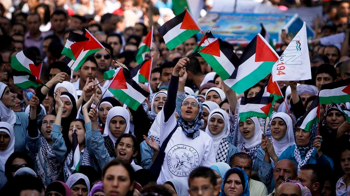 Palestinians wave flags during a rally in support of the Palestinian bid for statehood recognition in the United Nations. (AP)