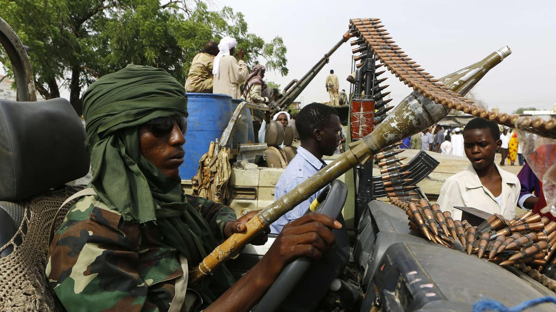 "(FILES) - A file picture taken on on May 3, 2015 shows a fighter from the Sudanese Rapid Support Forces sitting in an armed vehicle in the city of Nyala, in south Darfur as they display weapons and vehicles they say they captured from Dafuri rebels and fighters from The Justice and Equality Movement (JEM), lead by opposition leader Jibril Ibrahim, the previous week. Human Rights Watch on Wednesday accused a controversial Sudanese counter-insurgency unit of having carried out ""two sprees of killings and mass rape"" of civilians in conflict-riven Darfur since February 2014. AFP PHOTO / ASHRAF SHAZLY"