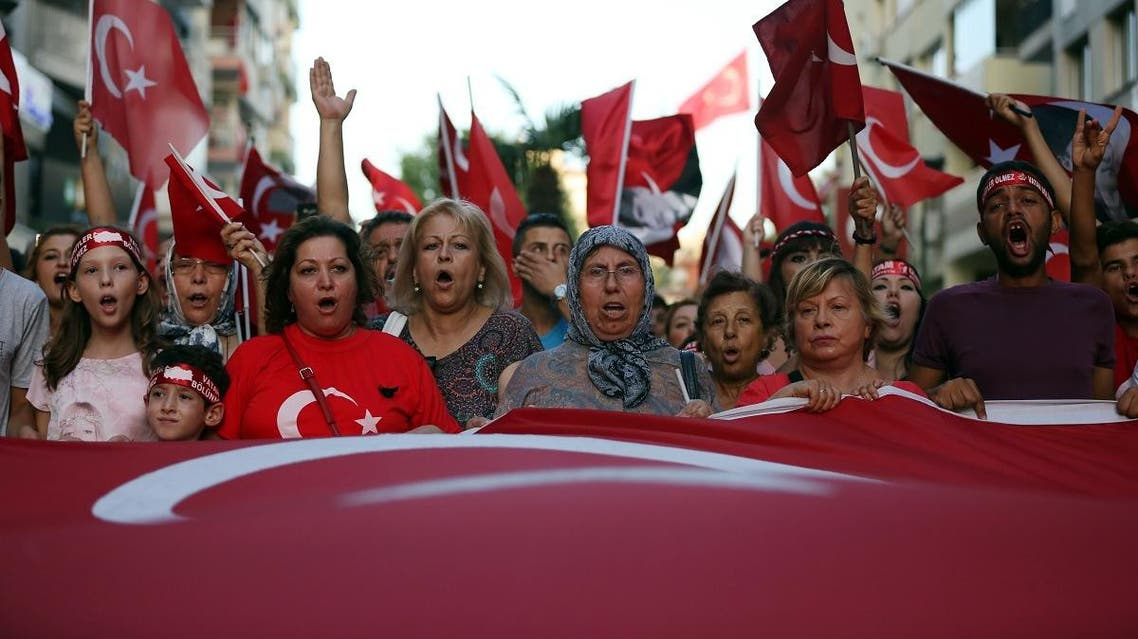 Thousands of people march to protest against the deadly attacks on Turkish troops, in Izmir, Turkey, late Wednesday. (AP)