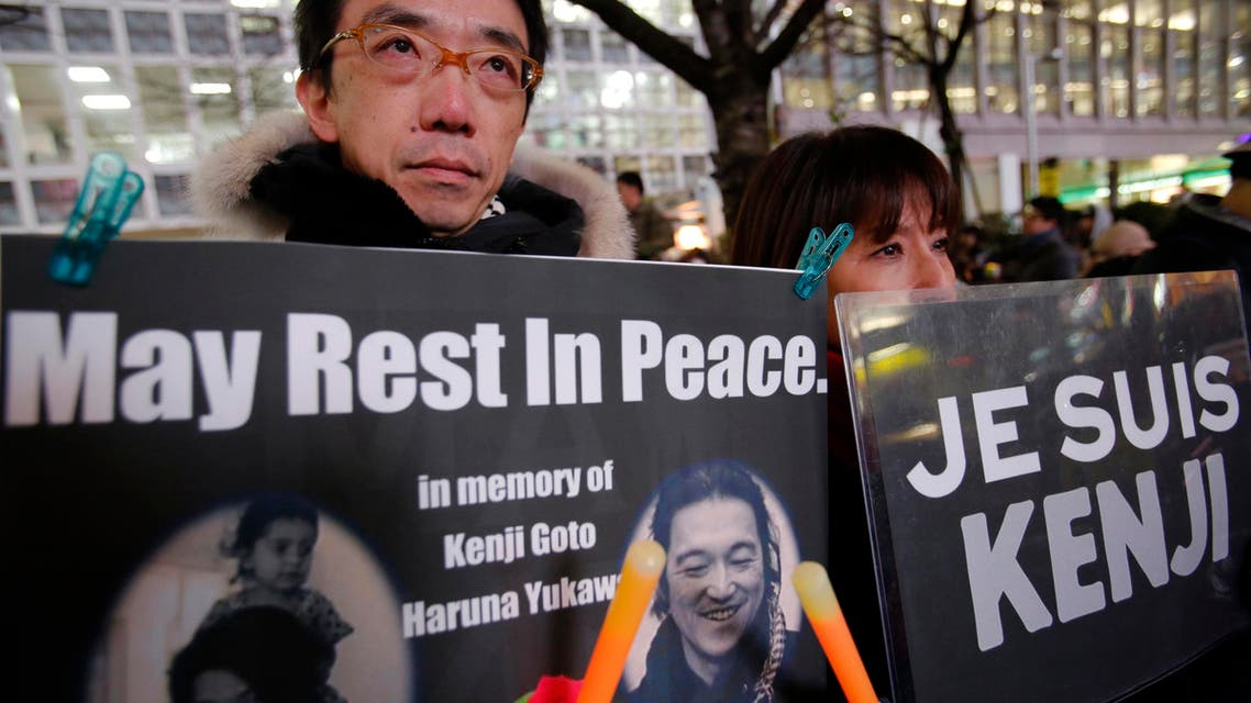 People gather to mourn two Japanese hostages, Kenji Goto and Haruna Yukawa, who were killed by the Islamic State group, in Tokyo,
