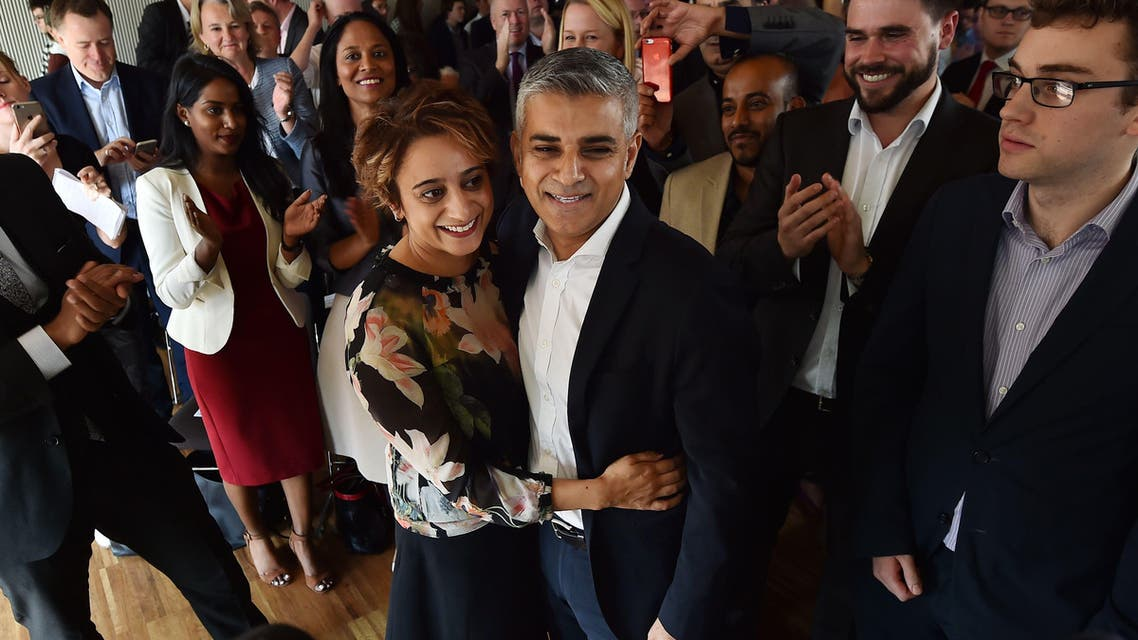 British Labour Party politician Sadiq Khan (CR) embraces his wife Saadiya (CL) after being selected to be Labour's candidate for the 2016 London mayoral election. (AFP)
