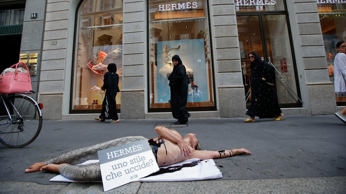 An activist of People for the Ethical Treatment of Animals, PETA stages a protest against Hermes at Milan's fashion shopping district, in Milan, Italy, Thursday, July 30 , 2015. Reuters