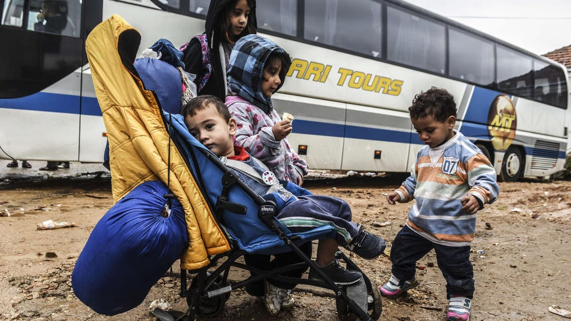 Children wait in front of a bus heading to Belgrade from the southern Serbian town of Presevo on September 11, 2015. (AFP)