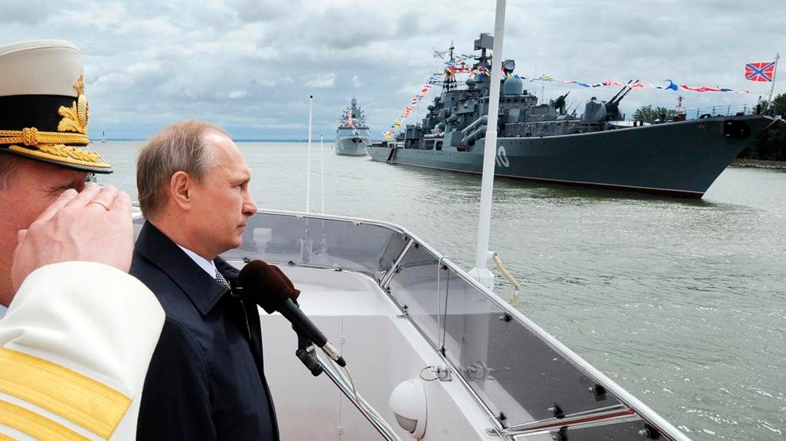 Russian President Vladimir Putin, second left, reviews a Navy parade in Baltiisk, western Russia, Sunday, July 26, 2015 during celebrations for Russian Navy Day.  AP