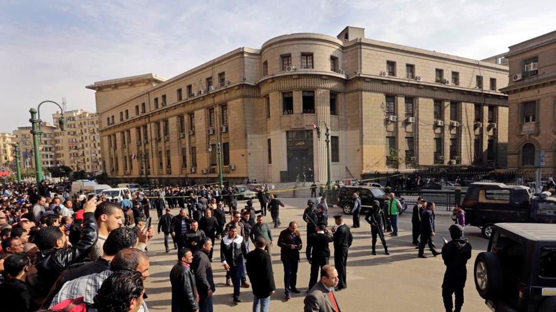 People gather the site of a bomb blast in front of the Egyptian High Court, in Cairo, Egypt, Monday, March 2, 2015. AP