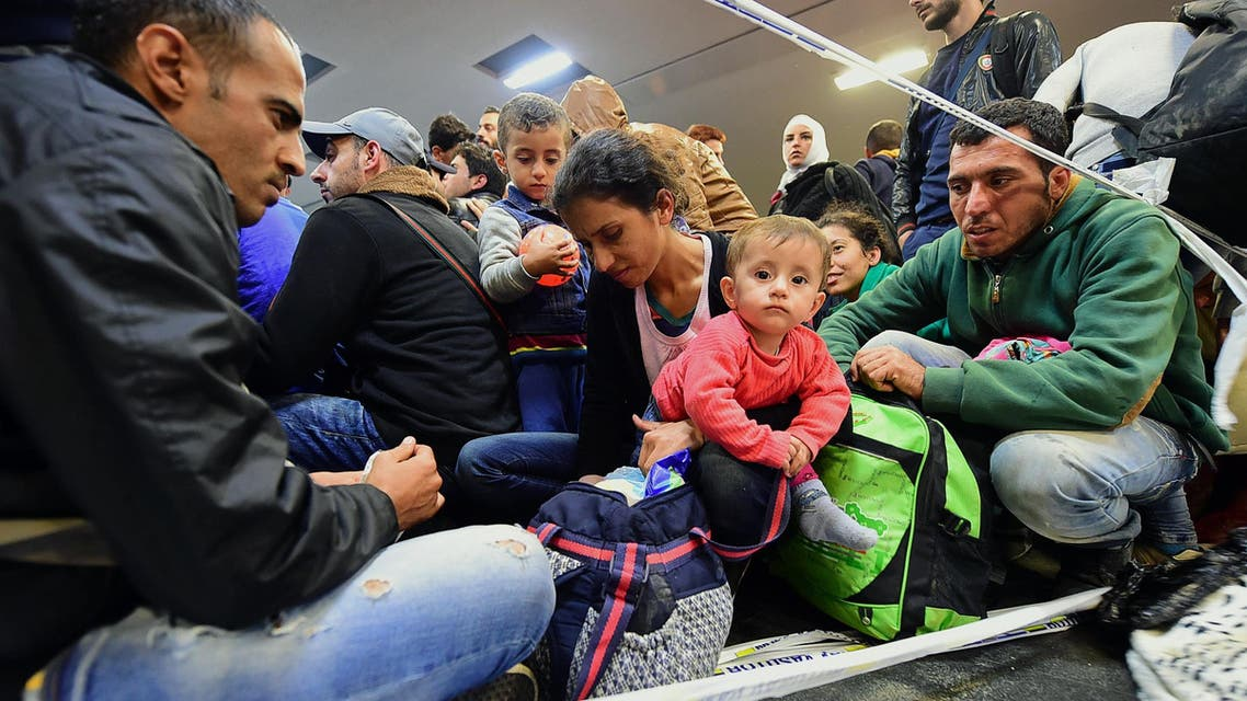 A refugee family waits to be allowed onto a train platform in the Hungarian capital of Budapest. (AFP)