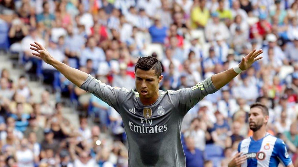 Real Madrid's Cristiano Ronaldo celebrates after scoring against Espanyol during a Spanish La Liga soccer match at Cornella-El Prat stadium in Cornella Llobregat, Spain, Saturday, Sept. 12, 2015. (AP Photo/Manu Fernandez)