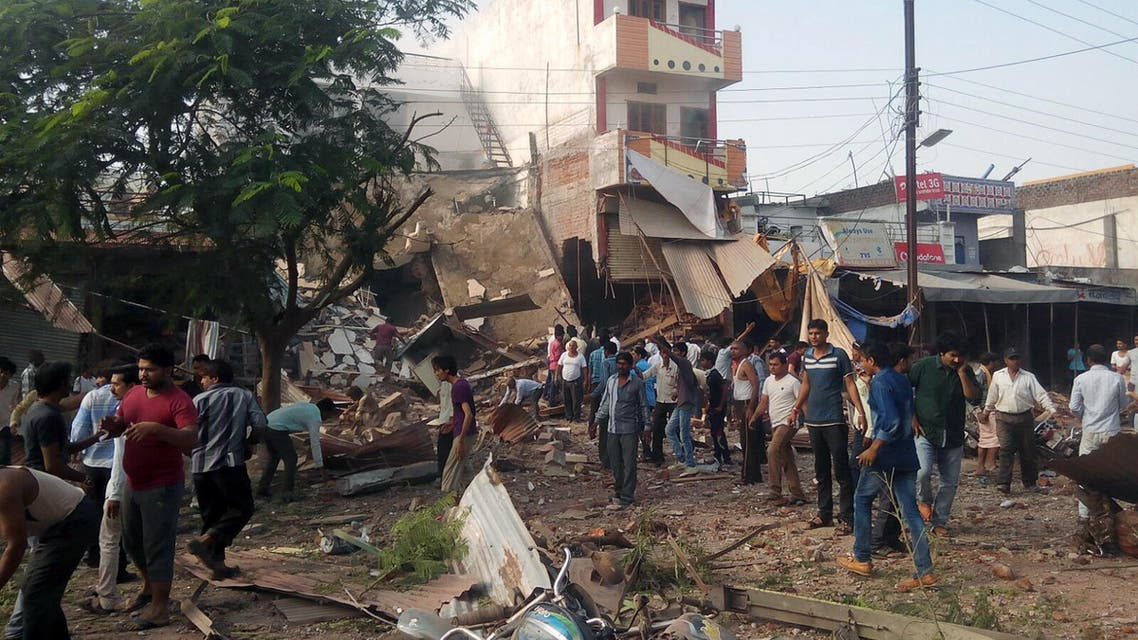 People gather around the site of an explosion at a restaurant in Jhabua district in the central Indian state of Madhya Pradesh on September 12, 2015.