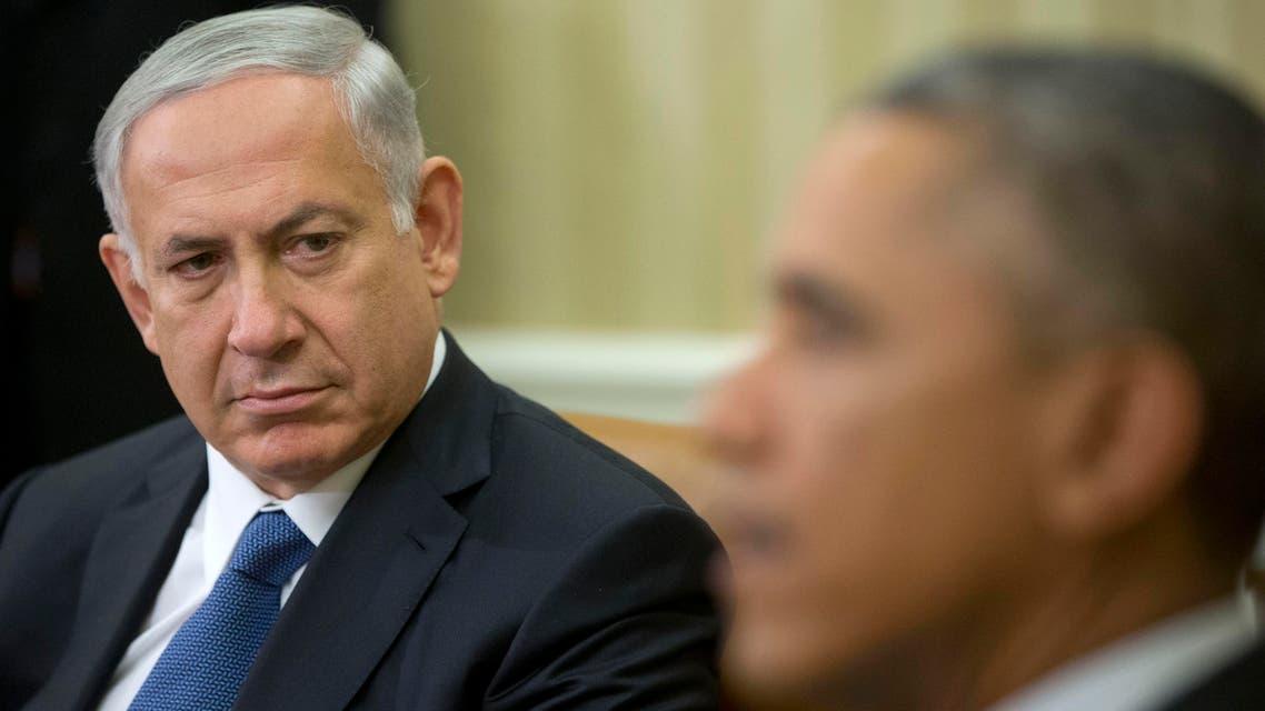 Israeli Prime Minister Benjamin Netanyahu listens as President Barack Obama speaks during their meeting in the Oval Office of the White House in Washington. ap